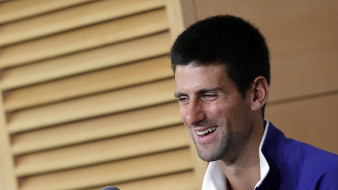Novak Djokovic of Serbia smiles during a press conference for the 2013 French Open tennis tournament, at Roland Garros stadium in Paris, Friday May, 24, 2013. (AP Photo/Christophe Ena)