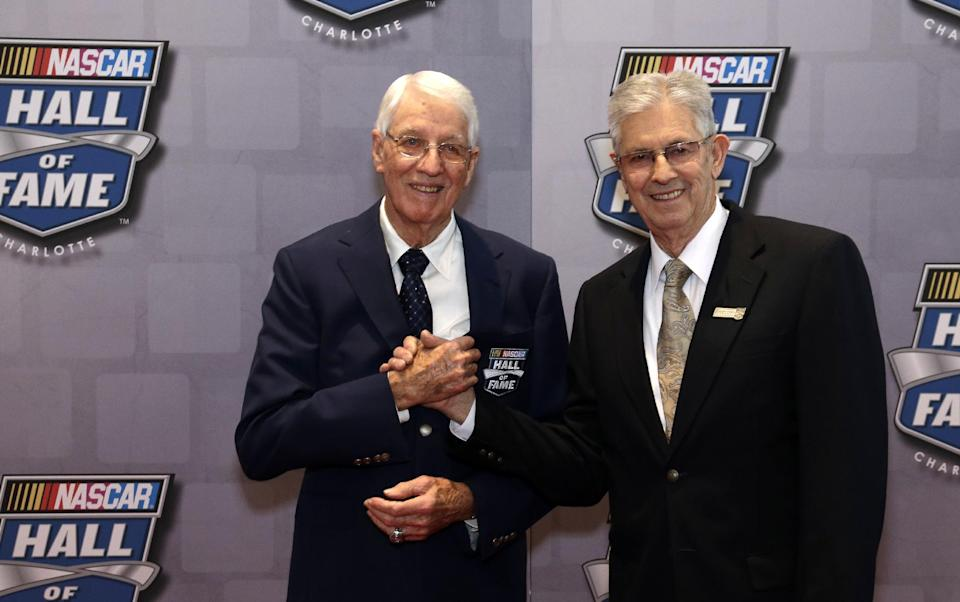 Leonard Wood, left, grabs the hand of his brother, Glen for photographers on the red carpet before the start of the NASCAR Hall of Fame Induction Ceremonies where Leonard will be inducted into the hall of fame, Friday Feb. 8, 2013 in Charlotte, N.C. (AP Photo/Bob Leverone)