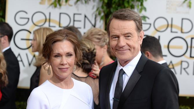Robin Dearden, left, and Bryan Cranston arrive at the 71st annual Golden Globe Awards at the Beverly Hilton Hotel on Sunday, Jan. 12, 2014, in Beverly Hills, Calif. (Photo by Jordan Strauss/Invision/AP)