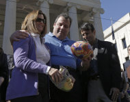 <p>               Louisiana Gov. Bobby Jindal, right, presents a ceremonial football to New Jersey Gov. Chris Christie, center, and his wife Patty before the NFL Super Bowl XLVII football game between the San Francisco 49ers and the Baltimore Ravens Sunday, Feb. 3, 2013, in New Orleans. New Jersey will host Super Bowl XLVIII. (AP Photo/Gerald Herbert)