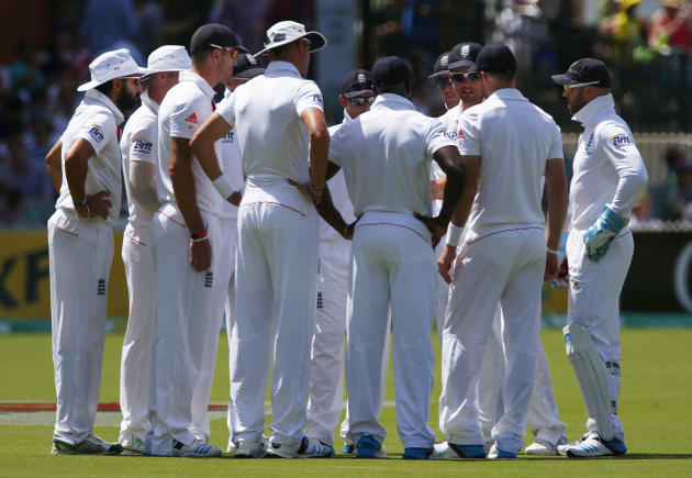 England's captain Cook talks to his team before the start of Australia's inning during the third day of the second Ashes test cricket match in Adelaide