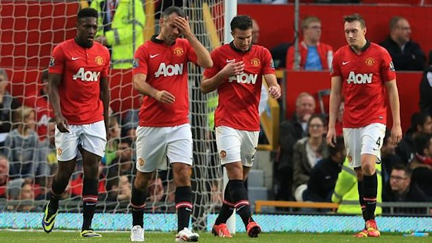Manchester United's Danny Welbeck (left), Ryan Giggs (second left), Robin van Persie (second right) and Phil Jones appear dejected after Southampton's Adam Lallana (not in picture) scores his team's equalising goal (PA Photos)