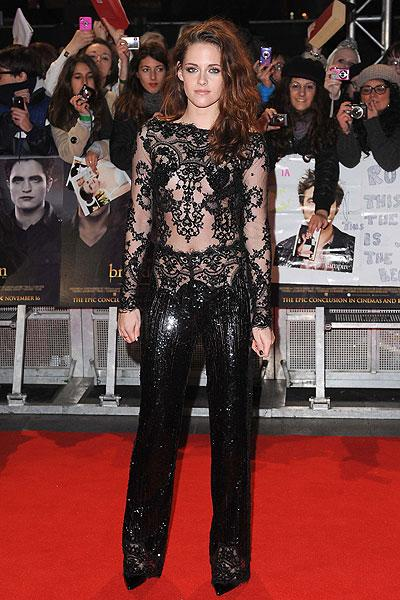 "Kristen Stewart continues her sheer lace trend in a glamorous Zuhair Murad jumpsuit at the ""Twilight: Breaking Dawn Part Two"" premiere in London, Nov. 14. Stewart looked every bit the starle"