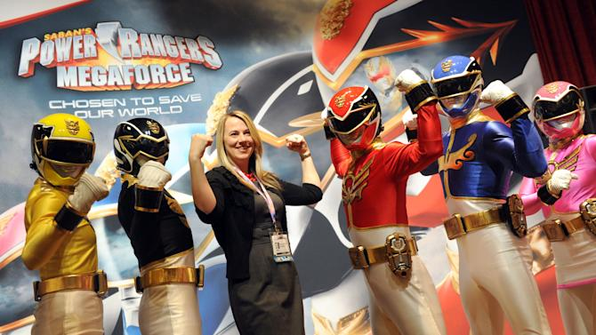 IMAGE DISTRIBUTED FOR SABAN BRANDS - Saban's Power Rangers Megaforce mingle with delegates at the three day Kidscreen Summit, Tuesday, Feb. 5, 2013, at the Hilton New York. Saban Brands is celebrating the 20th anniversary of the Power Rangers franchise at the conference. (Diane Bondareff/Invision for Saban Brands/AP Images)