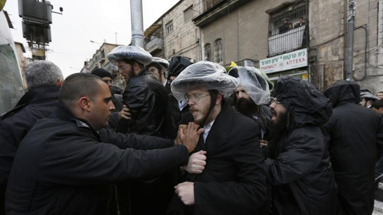 Ultra-Orthodox Jewish protesters scuffle with Israeli policemen during clashes in Jerusalem