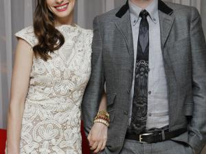 """FILE - In this Aug. 23, 2011 file photo, U.S actress Anne Hathaway and Adam Shulman arrive at the afterparty at The Sanderson hotel in central London for the European Premiere of """"One Day."""" Publicist Stephen Huvane confirmed Monday, Nov. 28, that the Oscar-nominated actress and Shulman are engaged. (AP Photo/Joel Ryan, file)"""