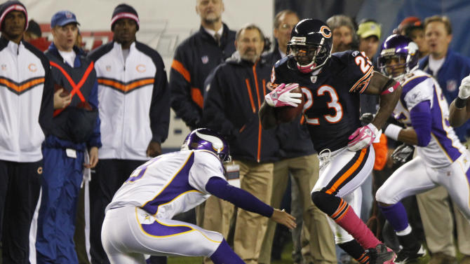 Chicago Bears wide receiver Devin Hester (23) avoids a tackle by Minnesota Vikings kicker Ryan Longwell on his way to a 98-yard kickoff return in the second half of an NFL football game, Sunday, Oct. 16, 2011, in Chicago. (AP Photo/Charles Rex Arbogast)