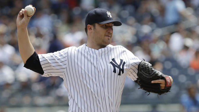 FILE - In this Aug. 10, 2013 file photo, New York Yankees' Phil Hughes delivers a pitch during the first inning of a baseball game against the Detroit Tigers Saturday in New York. The Minnesota Twins and Hughes agreed to a $24 million, three-year deal, a person with knowledge of the agreement told The Associated Press. The person requested anonymity because Hughes still has to pass a physical before the contract can become official. (AP Photo/Frank Franklin II, File)