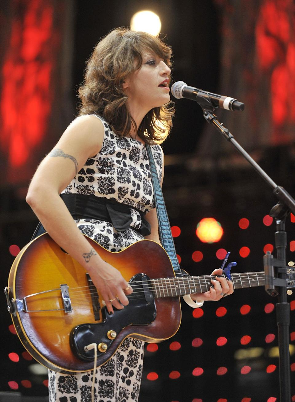 Sasha Dobson performs with her band during the Farm Aid 2013 concert at Saratoga Performing Arts Center in Saratoga Springs, N.Y., Saturday, Sept. 21, 2013. (AP Photo/Hans Pennink)