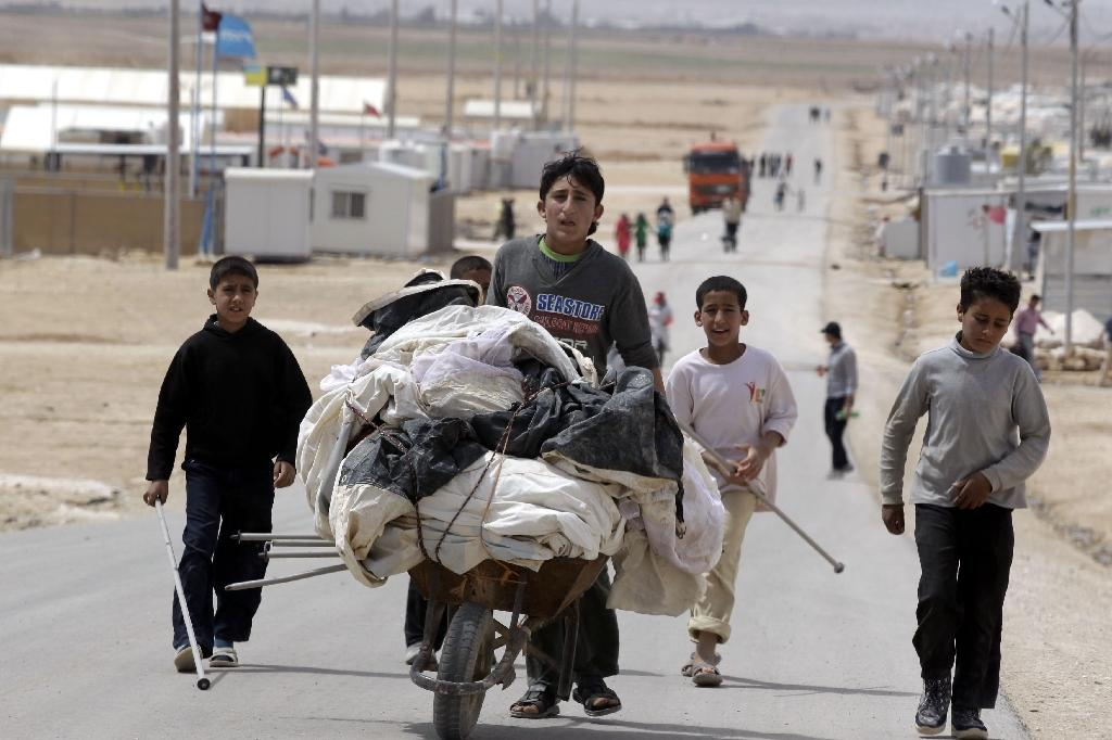 In U-turn, Britain to let in more Syrian child refugees
