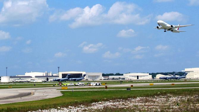 The first Boeing 787 manufactured in South Carolina takes off on its maiden flight from the Charleston International Airport in North Charleston, S.C., on Wednesday, May 23, 2012. It's the first plane manufactured at the $750 million assembly plant that opened last summer.   (AP Photo/Bruce Smith)