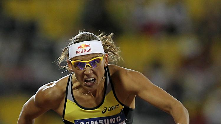 Lolo Jones of the US competes in the women's 100m hurdles at the IAAF Diamond League in Doha on May 6, 2011. AFP PHOTO/KARIM JAAFAR (Photo credit should read KARIM JAAFAR/AFP/Getty Images)