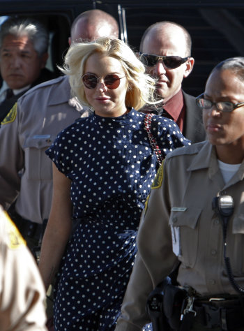 Actress Lindsay Lohan arrives for a probation hearing at Los Angeles Superior Court Wednesday, Nov. 2, 2011. A city prosecutor is advocating the starlet be sent back to jail for her latest violation of a court order. She remains on probation for a 2007 drunken driving case and a misdemeanor theft case. (AP Photo/Reed Saxon)