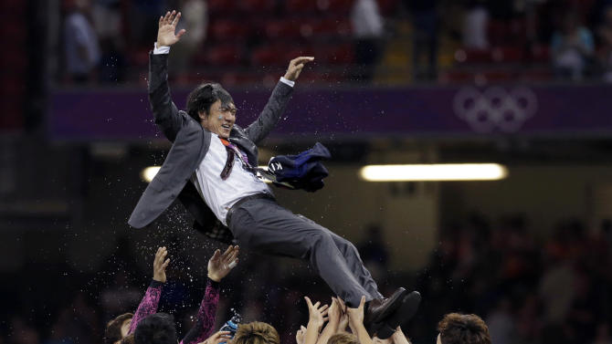 FILE - In this Friday, Aug. 10, 2012 file photo, South Korea head coach Hong Myung-bo is hoisted up by his players after the team won their men's soccer bronze medal match against Japan in Cardiff, Wales, at the 2012 London Summer Olympics.  (AP Photo/Luca Bruno, File)