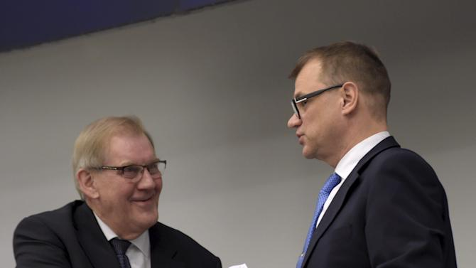 Juha Sipila (R) of the Centre Party is congratulated after Sipila was voted to become the next prime minister at the parliament in Helsinki