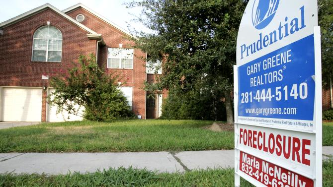 FILE - A foreclosure home for sale is shown in this Aug. 22, 2006 file photo taken in Spring, Texas. Ten major banks agreed Monday Jan. 7, 2013 to pay $8.5 billion to settle federal complaints that they wrongfully foreclosed on homeowners who should have been allowed to stay in their homes. (AP Photo/David J. Phillip, File)
