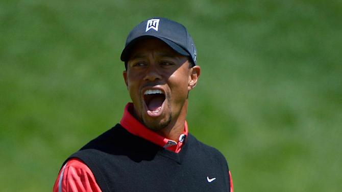 Tiger Woods reacts after missing a long putt for par on the 18th green during the final round of the Arnold Palmer Invitational golf tournament in Orlando, Fla., Monday, March 25, 2013. Woods won the tournament at 13-under par. (AP Photo/Phelan M. Ebenhack)