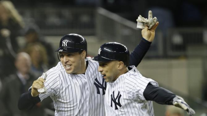 New York Yankees' Mark Teixeira, left, and  teammate Raul Ibanez celebrate after Ibanez hit a two-run home run in the ninth inning of Game 1 of the American League championship series against the Detroit Tigers Saturday, Oct. 13, 2012, in New York. (AP Photo/Paul Sancya )