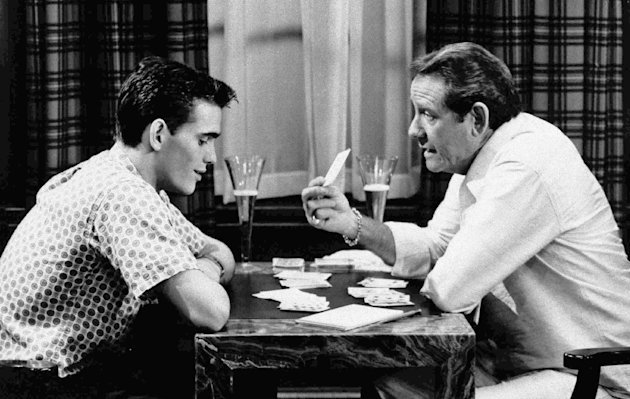 "FILE - In this undated file photo, veteran actor Richard Crenna, right, and Matt Dillon play cards in scene from the 1984 film ""The Flamingo Kid."" (AP Photo/20th Century Fox, File)"