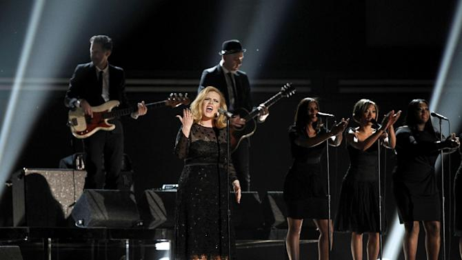 FILE - In this Feb. 12, 2012 file photo, singer Adele performs during the 54th annual Grammy Awards in Los Angeles. The Staples Center in Los Angeles will once again be the stage for the Grammy Awards, airing Feb. 10, 2013. The nominations will be revealed about two months earlier on Dec. 5 during a live primetime concert on CBS. (AP Photo/Matt Sayles, file)