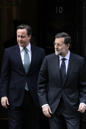 Spanish Prime Minister Mariano Rajoy, right, and British Prime Minister David Cameron leave 10 Downing Street in London after their talks, Tuesday, Feb. 21, 2012. (AP Photo/Sang Tan)