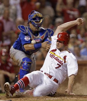 St. Louis Cardinals' Matt Holliday (7) scores from second on a single by Yadier Molina as Chicago Cubs catcher Geovany Soto can't control the ball in the sixth inning of a baseball game, Friday, July 29, 2011 in St. Louis. (AP Photo/Tom Gannam)