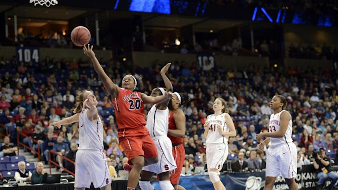 Georgia's Shacobia Barbee (20) drives through Stanford's defense in the first half of a regional semifinal in the NCAA women's college basketball tournament, Saturday, March 30, 2013, in Spokane, Wash. (AP Photo/Jed Conklin)