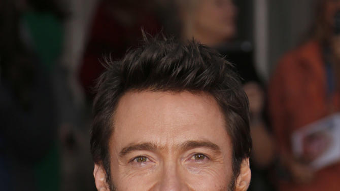 Hugh Jackman arrives at the 19th Annual Screen Actors Guild Awards at the Shrine Auditorium in Los Angeles on Sunday Jan. 27, 2013. (Photo by Todd Williamson/Invision for The Hollywood Reporter/AP Images)