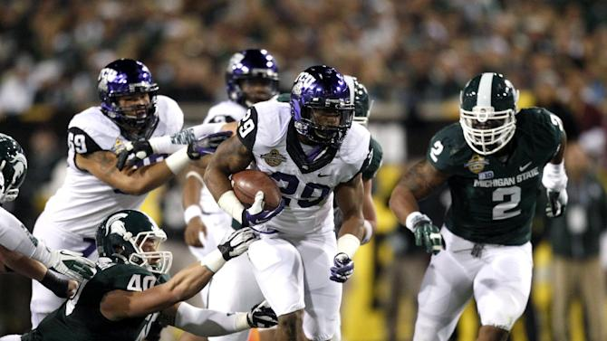 TCU's Matthew Tucker (29) carries the ball during the first quarter of the Buffalo Wild Wings Bowl NCAA college football game against Michigan State at Sun Devil Stadium, Saturday, Dec. 29, 2012, in Tempe, Ariz. (AP Photo/The Arizona Republic, )  MARICOPA COUNTY OUT; MAGS OUT; NO SALES