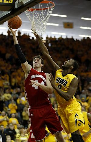 No. 16 Wisconsin beats No. 15 Iowa 79-74