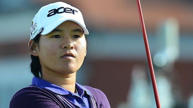Yani Tseng of Taiwan plays her tee shot to the third during the first round of the Women's British Open golf tournament at the Royal Liverpool Golf Club in Hoylake, northern England, on September 13, 2012. AFP