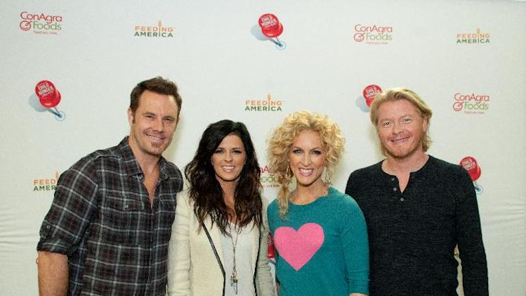 November 13, 2012, This year's Country Music Association Award winners, Little Big Town, pose for a photo at Second Harvest Food Bank of Middle Tennessee. (Dean Dixon/AP Images for ConAgra)