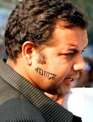 "Nepalese film director Manoj Pandit is pictured with the word ""Badhshala"" (Slaughterhouse) written on his face, during a Human Rights Day rally in Kathmandu on December 10, 2012. The makers of a film in Nepal depicting torture by the army accused the government of censorship on Friday after they had to cancel the movie's release because of delays in getting approvals"