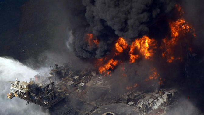 FILE - In this April 21, 2010 aerial file photo taken in the Gulf of Mexico more than 50 miles southeast of Venice, La., the Deepwater Horizon oil rig is seen burning. A U.S. judge on Tuesday, Jan. 29, 2013, approved an agreement for British oil giant BP PLC to plead guilty to manslaughter and other charges and pay a record $4 billion in criminal penalties for the company's role in the 2010 oil disaster in the Gulf of Mexico. (AP Photo/Gerald Herbert, File)