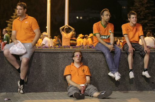 Netherlands' fans react at the end of their Euro 2012 soccer match against Germany at the Metalist stadium in Kharkiv
