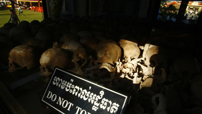 """In this photo taken, May 20, 2013, hundreds of former Khmer Rouge victims' bone and skulls are displayed in a memorial at Choeung Ek """"Killing Field"""" in Phnom Penh, Cambodia. Cambodian Prime Minister Hun Sen appealed Monday, May 27, to member of parliaments urgently drafting a law in aims to punishment an opposition party leader from he recently comments that former Khmer Rouge's notorious S-21 prison was not real but created by Vietnamese, a move that could bar his opponent from participant upcoming election. (AP Photo/Heng Sinith)"""