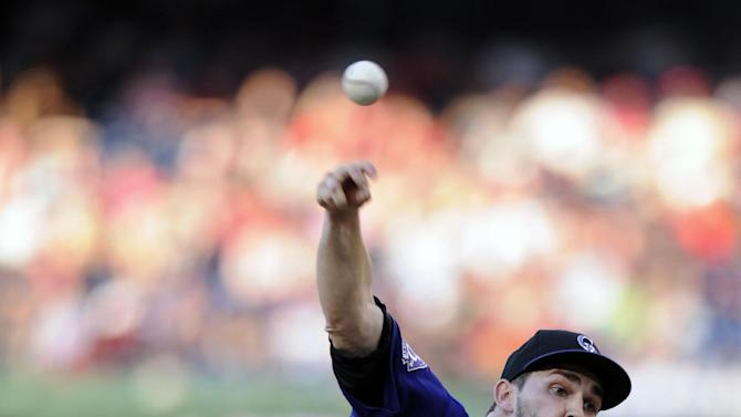 Colorado Rockies starting pitcher Tyler Chatwood delivers a pitch against the Washington Nationals during the first inning of a baseball game, Friday, June 21, 2013, in Washington. (AP Photo/Nick Wass)