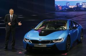 BMW CEO Norbert Reithofer presents BMW i8 hybrid supercar at Frankfurt Motor Show