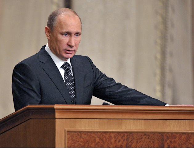 Russian President Vladimir Putin addresses senior military officials in Moscow on Wednesday, Feb. 27, 2013. Russian President Vladimir Putin has called on the country's top brass to deliver a drastic 