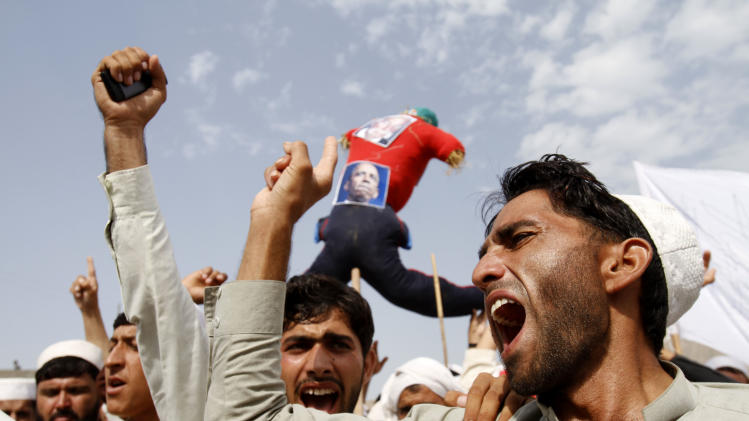 Afghans shout anti-American slogans in the Ghanikhel district of Nangarhar province, east of Kabul, Afghanistan, Friday, Sept. 14, 2012 during a protest against an anti-Islam film which depicts the Prophet Muhammad as a fraud, a womanizer and a madman. (AP Photo/Rahmat Gul)