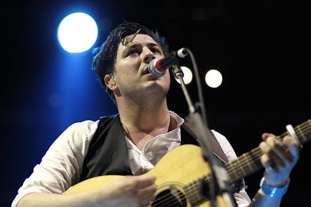 Marcus Mumford, of Mumford & Sons, performs at the Myspace Big Easy Express concert at SXSW in Austin, Texas, Saturday, March 17, 2012. (Jack Dempsey/AP Images for Myspace)