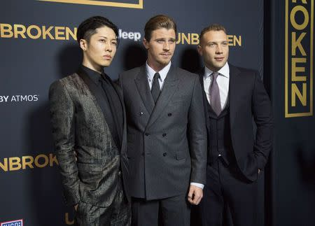 "Cast members Ishihara, Hedlund and Courtney pose at the premiere of ""Unbroken"" at Dolby theatre in Hollywood"