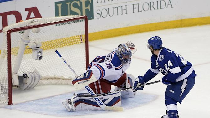 Tampa Bay Lightning right wing Ryan Callahan (24) scores against New York Rangers goalie Henrik Lundqvist (30), of Sweden,during the first period of Game 6 of the Eastern Conference finals in the NHL hockey Stanley Cup playoffs. Tuesday, May 26, 2015, in Tampa, Fla. (AP Photo/Phelan M. Ebenhack)
