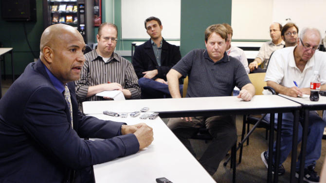 Cleveland Indians bench coach Sandy Alomar Jr., left, speaks during a baseball news conference after interviewing for the vacant Boston Red Sox manager position at Fenway Park in Boston on Wednesday, Nov. 9, 2011.(AP Photo/Bizuayehu Tesfaye)