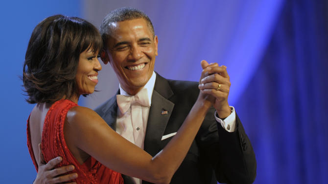 President Barack Obama dances with first lady Michelle Obama during The Inaugural Ball at the Washignton convention center during the 57th Presidential Inauguration in Washington, Monday, Jan. 21, 2013. (AP Photo/Cliff Owen)