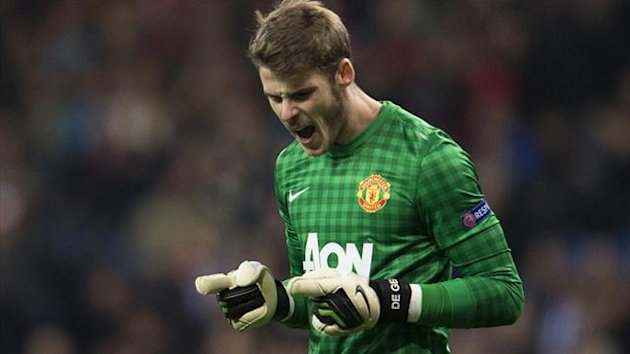 Manchester United goalkeeper David de Gea reacts at the end of the Champions League round of 16 first leg match against Real Madrid (AFP)