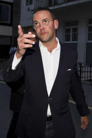 FILE - This is a  Sunday July 10, 2011 photo of the then Chief executive of News Corporation Europe and Asia, James Murdoch gesturing as he leaves his father Chairman of News Corporation Rupert Murdoch's residence, in central London. James Murdoch said Wednesday March 14, 2012  'I could have asked more questions' about phone hacking at News International.  (AP Photo/Sang Tan, File)