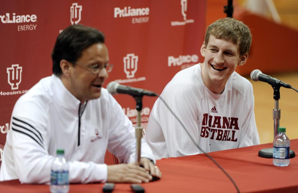 Indiana men's basketball coach Tom Crean speaks as forward Cody Zeller listens during a news conference where Zeller said he will enter the NBA draft, at Assembly Hall in Bloomington, Ind., Wednesday, April 10, 2013. (AP Photo/The Herald-Times, Chris Howell)