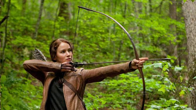 "FILE - In this image released by Lionsgate, Jennifer Lawrence portrays Katniss Everdeen in a scene from ""The Hunger Games."" Lionsgate announced Thursday, Nov. 1, 2012, that ""The Hunger Games: Catching Fire"" filmmaker Francis Lawrence would also direct ""The Hunger Games: Mockingjay Part One"" and ""Part Two."" (AP Photo/Lionsgate, Murray Close, File)"