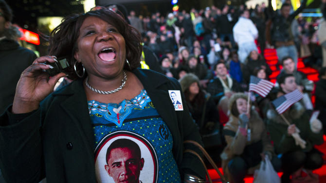 Martha Nunez, 53, of the Bronx, reacts to positive predictions for President Barack Obama as crowds watch election results in Times Square, Tuesday, Nov. 6, 2012, in New York. After a year of campaigning, polls have begun to close after Americans across the United States headed to the polls to decide the winner of the tight presidential race between President Barack Obama and Republican presidential candidate, former Massachusetts Gov. Mitt Romney. (AP Photo/ John Minchillo)